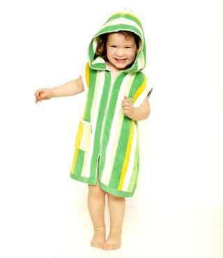 child wearing green striped beach towel robe by terry rich