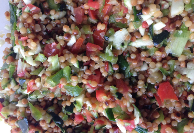 Salad with Pearl couscous and parsley.