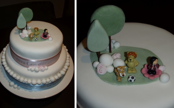 Two layered royal icing cake designed with pink and blue ribbon for boys and girls.