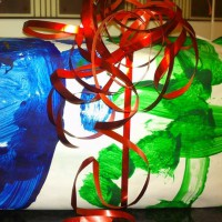 Reuse your kids paintings as wrapping paper