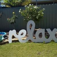 'Relax' backyard sign