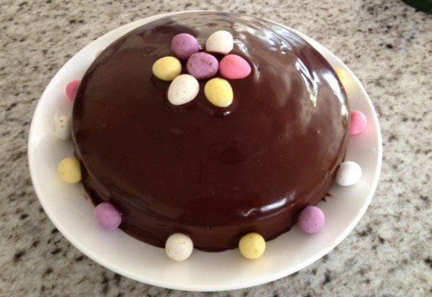 Decorating a chocolate cake for Easter Cake