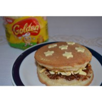Golden® Crumpets with Oats topped with peanut butter, Chocolate Hazelnut Spread and Cheese