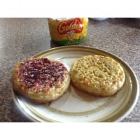 Golden® Crumpets with Oats topped with Golden Syrup and Blackberry Jam