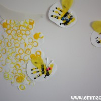 Bottle beehive with hand print bees