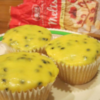 White chocolate & coconut cakes with white choc & passionfruit icing