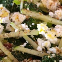 Broccoli and apple salad with toasted almonds and goats cheese