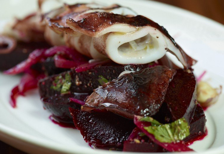Calamari Cooked in Olive Oil with a spiced beetroot salad.