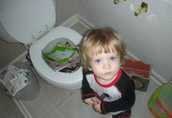 When good kids do bad things_kid putting magazines into toilet_585x402