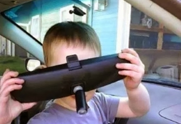 When good kids do bad things_kid with rearview mirror removed from car_585x402
