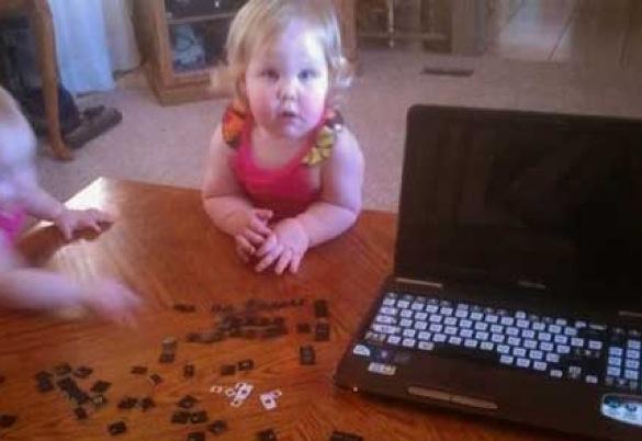 When good kids do bad things_kids removing laptop keys_585x402