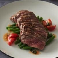 Lamb backstrap with tomato, basil and parmesan sauce