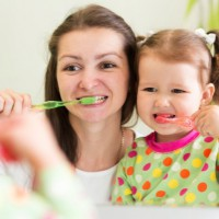 Tips for teaching children to brush and floss their teeth