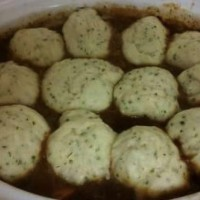 Braised beef and guiness stew with herb and cheese dumplings