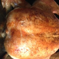 Traditional Christmas roast chicken with thyme and onion stuffing