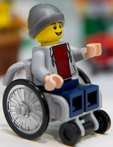 Lego child in a wheelchair also comes with an assistance dog. Image source: Getty Images.