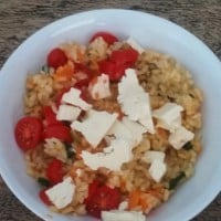 Pumpkin risotto with cherry tomatoes