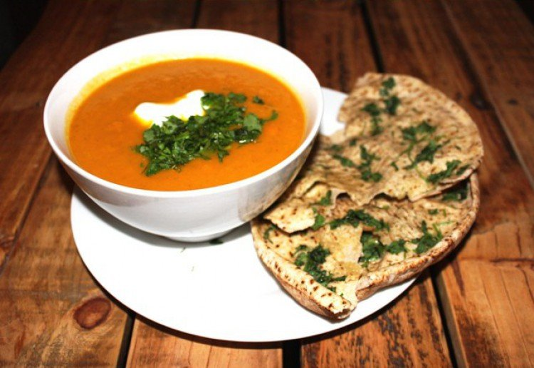 Rustic carrot and coriander soup with crispy pitta