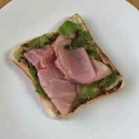 Smashed avo on toast with vegemite and ham