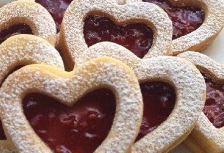 buttery heart shaped biscuits with jam centres dusted with icing sugar