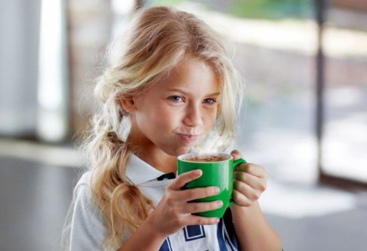MILO product review main image showing little girl drinking a green cup of MILO