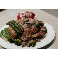 Baked Chicken with Mushrooms and Vegetables in a Cream Sauce