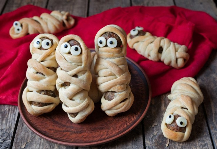 halloween recipes like these turkey sausages wrapped in strips of puff pastry to look like little mummies are awesome