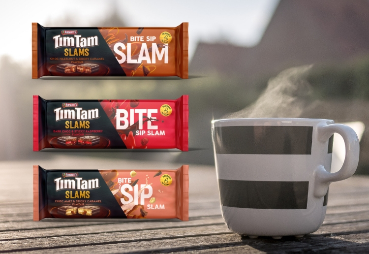hot cup of coffee on outdoor table with new range of tim tam slams