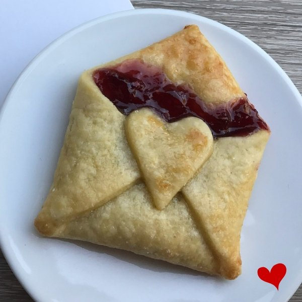 Puff Pastry made into a cute little square envelope filled with strawberry jam sealed with a pastry heart