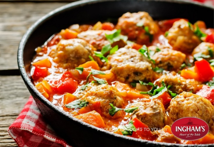 Large wide saucepan filled with turkey mince meatballs in a delicious tomato based sauce. The Turkey and Tomato Hotpot recipe also includes carrots, capsicum and is topped with a sprinkling of fresh flat leaf parsley.