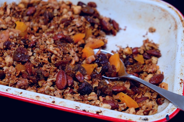Toasted crunchy granola containing oats almonds apricots sultanas and other dried fruit
