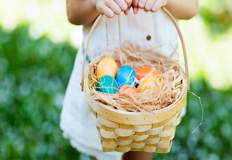 Girl Holding Basket At Easter Egg Hunt