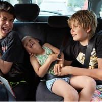 Good News For Kids Stuck in the Middle on Long Car Trips!