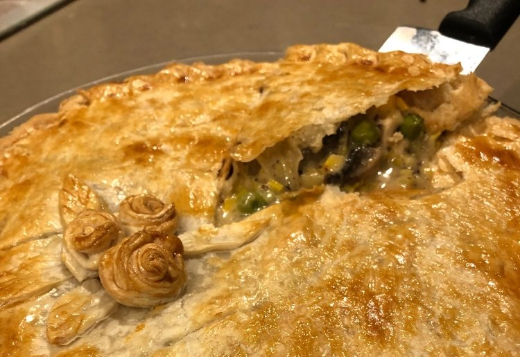 Flaky Pastry with pastry rosettes on top of a chicken and leek pie