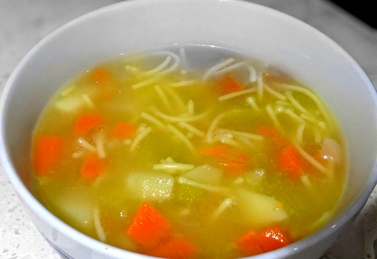 healthy and delicious vegetable and noodle soup. Clear base soup with carrots and noodles