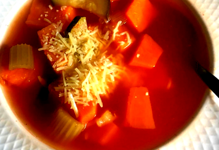 Delightful red vegetable soup in a white bowl