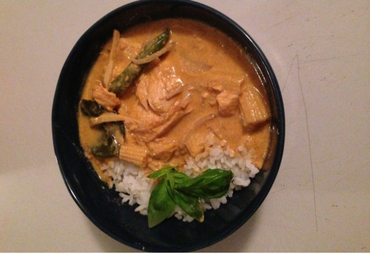 thai red curry with rice basil Asian vegetables. Creamy curry