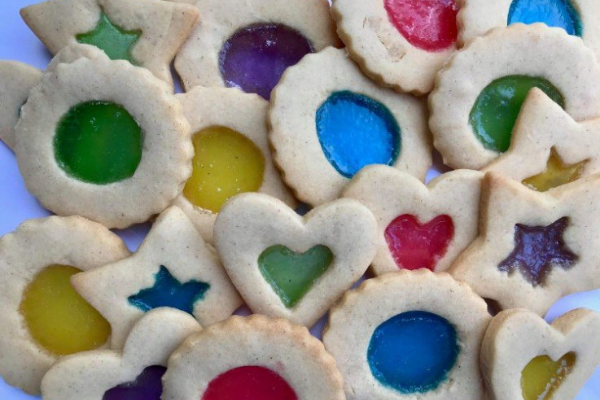 Stain Glass Cookies with a cut out on the top layer and brightly coloured jelly filling