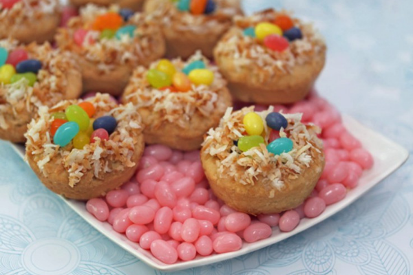 Small Jelly Bean Nest Cookies topped with shredded coconut and colourful jelly beans on a bed of pink jelly beans