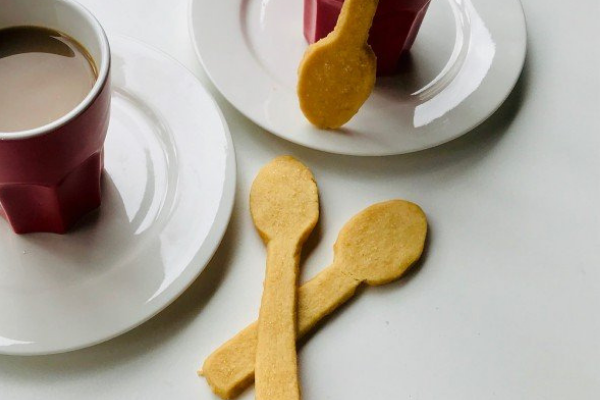 Malt biscuits shaped into a spoon shape and served with a coffee