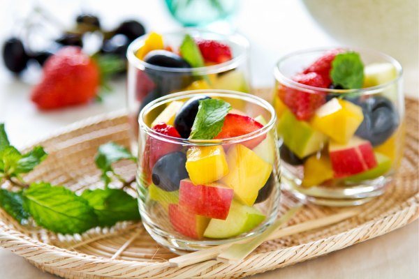 Small glasses filled with colourful fresh fruit