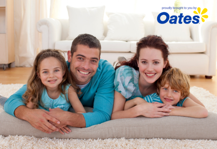 home cleaning tips to help happily family lying on a carpet rug with allergies