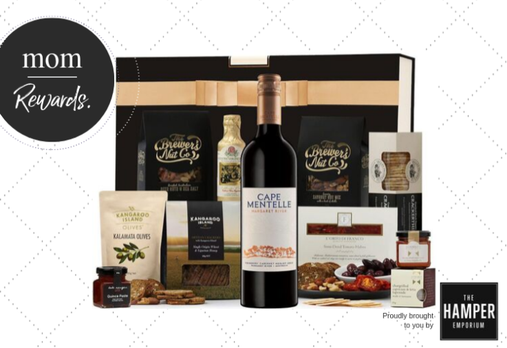 A picture of the contents of the red wine and nibbles hamper including a bottle of red wine, a black case and nuts
