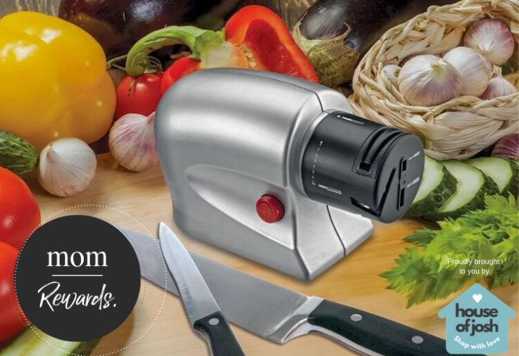 A knife sharpener with sharp knives on a wooden bench with fresh vegetables in the background
