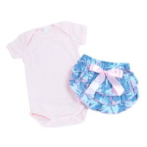 Ba by pink onsie and blue nappy cover with a pink bow