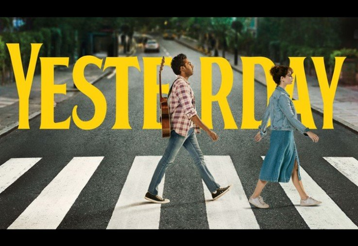Two people walking across a stret crossing with the word yesterday in the background