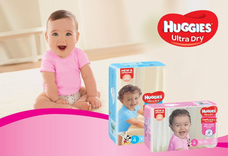 Photo of packs of New Improved Huggies Ultra Dry Nappies with a happy baby and a huggies logo