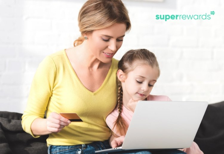 Super Rewards being earnt by a mum shopping online on a laptop with her daughter