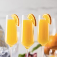 Refreshing fruity mimosa cocktail