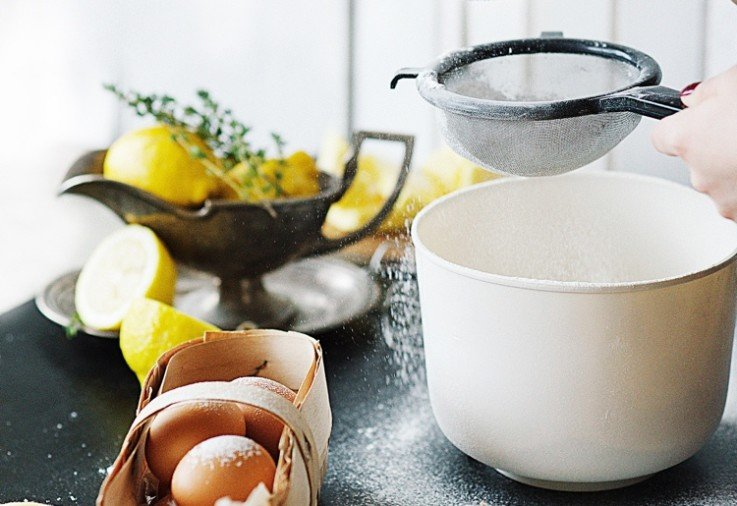 all purpose flour being sifted with whole eggs